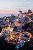 Illuminated Oia village. Oia village at sunset with illumination turned on, Santorini, Greece Stock Image
