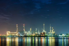 Illuminated of oil and gas refinery plant Stock Photos