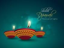 Illuminated oil lit lamps for Happy Diwali celebration. Royalty Free Stock Photos