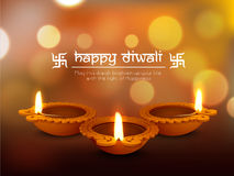 Illuminated oil lit lamps for Happy Diwali celebration. Stock Photo