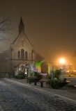 Illuminated old church in a december evening fog Royalty Free Stock Photo