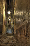 Illuminated Old Town alley. Stock Images
