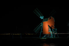 Illuminated old wooden windmill. Illumineted old wooden windmill at the Swedish island Oland, the island of sun and wind Stock Photo