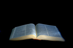 Illuminated open Bible Royalty Free Stock Image
