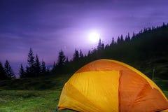 Illuminated orange camping tent Royalty Free Stock Photography