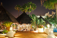 Illuminated outdoor restaurant at luxury hotel Stock Images