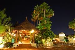 Illuminated outdoor restaurant at luxury hotel Stock Photography