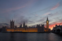 Houses of Parliament in London at dusk. Illuminated Palace of Westminster or Houses of Parliament in London photographed at dusk Stock Image