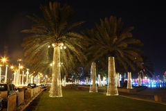 Illuminated palm trees in Doha Stock Photo
