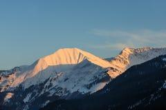 Illuminated peaks of austrian mountain Stock Photos