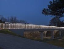 Illuminated pedestrian bridge Stock Photography