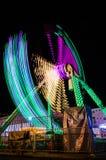 Illuminated Pendulum On Lunapark At Night. Illuminated pendulum on an amusement park at night Royalty Free Stock Images