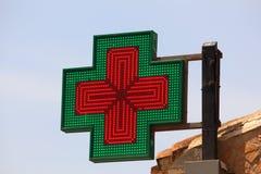 Illuminated pharmacy sign Stock Images