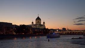 Illuminated pleasure boat sails across Moscow River stock video
