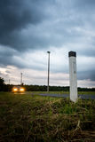 Illuminated pole on roadside Stock Image