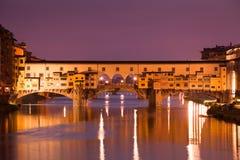 Illuminated Ponte Vecchio in Florence. Illuminated famous bridge Ponte Vecchio in Florence, Tuscany, Italy Royalty Free Stock Image