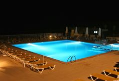 Illuminated pool at night Royalty Free Stock Photo