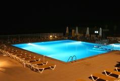 Illuminated pool at night. View of an illuminated pool at night Royalty Free Stock Photo