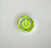 Illuminated power button Royalty Free Stock Image