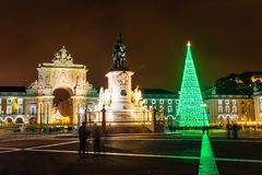 Illuminated Praca do Comercio at night in Lisbon. Illuminated Praca do Comercio Commerce Square at night in Lisbon, with a modern Christmas tree Royalty Free Stock Photography