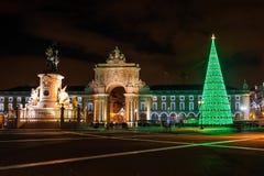 Illuminated Praca do Comercio at night in Lisbon. Illuminated Praca do Comercio Commerce Square at night in Lisbon, with a modern Christmas tree Stock Photo