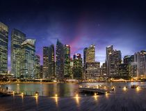 Downtown lights at dusk in Singapore bay Royalty Free Stock Image