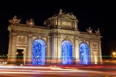 Illuminated Puerta de Alcalá in Christmas in Madrid Royalty Free Stock Photos
