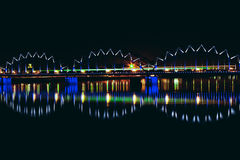 Illuminated railroad bridge. In night cityscape, Latvia. Riga bridge Royalty Free Stock Images