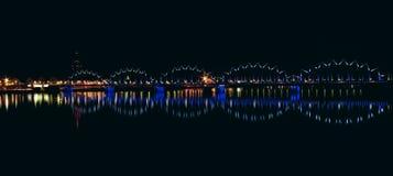 Illuminated railroad bridge stock images
