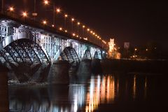 Illuminated railway bridge in Warsaw ( Poland) Royalty Free Stock Photo
