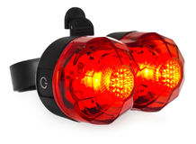 Illuminated rear bike lamp, plastic in a red color. Royalty Free Stock Photo