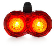 Illuminated rear bike lamp, plastic in a red color. Royalty Free Stock Images