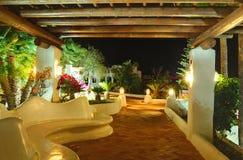 Illuminated recreation area of luxury hotel Stock Photos