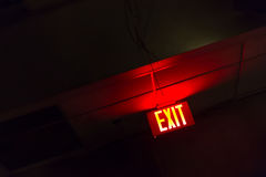 Illuminated red exit sign Royalty Free Stock Photography