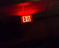 Illuminated red exit sign Stock Photos