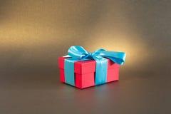 Illuminated red gift box Stock Photos