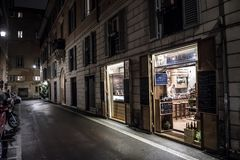 Illuminated Restaurant in Abandoned Street in Rome in Italy. At Night stock image