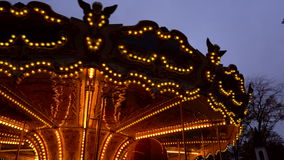 Illuminated retro carousel at night. In the city park stock video footage