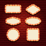 Illuminated retro frames set with shining lights on the contour and space for text Stock Photos