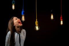 Illuminated retro lamps with woman yelling Royalty Free Stock Photos