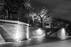 Illuminated riverbank with staircase in the middle of Frankfurt am Main Royalty Free Stock Images