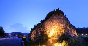 Illuminated Rock Formation. The massive rock formation, showing the geological lines during its forming in Durbuy, the smallest city in Europe at night Royalty Free Stock Photography