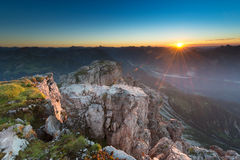 Illuminated rocks on the top of mountain Stock Photography