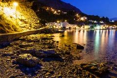 Illuminated Rocky Beach and Transparent Sea Royalty Free Stock Photo