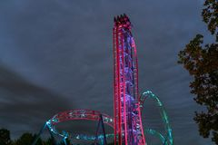 Illuminated roller coaster ride at night royalty free stock photography