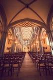 Illuminated Roman Catholic Church with Stained Glass Windows stock photo