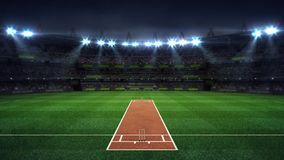 Illuminated round cricket stadium full of fans at night upper front view royalty free stock images
