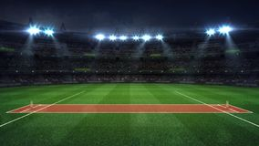 Illuminated Round Cricket Stadium Full Of Fans At Night Upper Side View Stock Images