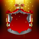 Illuminated royal mantle and gold crown with red signboard Stock Images