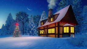 Illuminated rustic house and christmas tree at night. Cozy rustic house with smoking chimney and icicles on the eaves and illuminated christmas tree with red Royalty Free Stock Photos